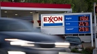 A vehicle passes an Exxon Mobil Corp. gas station in Arlington, Virginia, U.S., on Wednesday, April 29, 2020. Exxon is scheduled to released earnings figures on May 1.