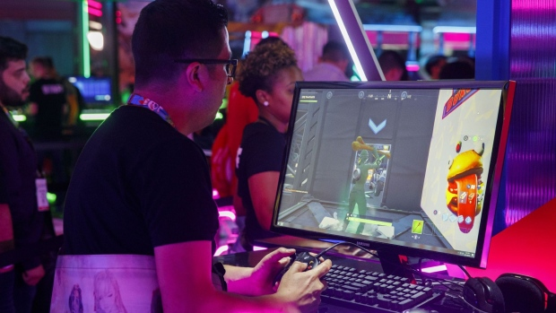An attendee plays the Epic Games Inc. Fortnite video game during the E3 Electronic Entertainment Expo in Los Angeles, California, U.S., on Tuesday, June 11, 2019. For three days, leading-edge companies, groundbreaking new technologies and never-before-seen products are showcased at E3. Photographer: Patrick T. Fallon/Bloomberg