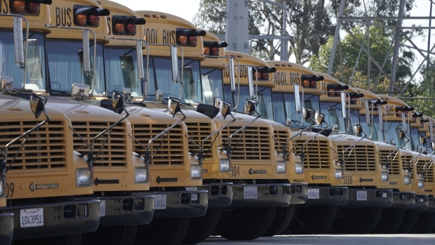 Navistar International Corp. school buses are stored at the San Diego Unified School District Transportation Department in San Diego, California, U.S., on Thursday, July 9, 2020. The U.S. economy is caught in the middle of President Trump's tug-of-war to reopen schools -- and could end up damned no matter what happens. Photographer: Bing Guan/Bloomberg