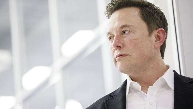 Elon Musk, chief executive officer of Space Exploration Technologies Corp. (SpaceX) and Tesla Inc., listens as Jim Bridenstine, administrator of the U.S. National Aeronautics and Space Administration (NASA), not pictured, speaks during an event at SpaceX headquarters in Hawthorne, California, U.S., on Thursday, Oct. 10, 2019.