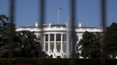 The south side of the White House stands past a fence in Washington, D.C.