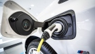 An electric charging plug sits connected to a BMW automobile inside a Bayerische Motoren Werke AG showroom in Frankfurt, Germany, on Tuesday, Aug. 4, 2020.
