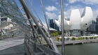 "The Artscience Museum, right, is seen from the Helix Bridge by Marina Bay in Singapore on Monday, July 6, 2020. Prime Minister Lee Hsien Loong vowed to hand over Singapore ""intact"" and in ""good working order"" to the next generation of leaders, predicting the coronavirus crisis will ""weigh heavily"" on the nation's economy for at least a year. Photographer: Wei Leng Tay/Bloomberg"