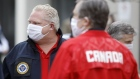 Doug Ford, Ontario's premier, wears a protective mask as he arrives at an event to hand out meals provided by Maple Leaf Sports & Entertainment (MLSE) to healthcare workers outside Centenary Hospital in Toronto, Ontario, Canada, on Friday, April 24, 2020. MLSE and their partners are looking to prepare and deliver 10,000 meals a day for front-line health-care workers and vulnerable community members.
