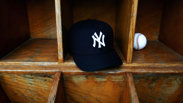 TAMPA, FL - FEBRUARY 25: A New York Yankees cap and a baseball are seen at Legends Field on February 25, 2005 in Tampa, Florida. (Photo by Ezra Shaw/Getty Images)