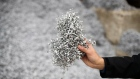 A worker holds a handful of aircraft grade aluminum shavings at the ABC Recycling Ltd. scrap metal recycling facility in Vancouver, British Columbia, Canada, on Friday, Feb. 8, 2019. Statistics Canada (STCA) is scheduled to release raw materials price index figures on February 28. Photographer: James MacDonald/Bloomberg
