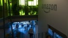 Attenddees walk inside of the Amazon.com Inc. office after the company's product reveal launch event in downtown Seattle, Washington, U.S., on Wednesday, Sept. 27, 2017.