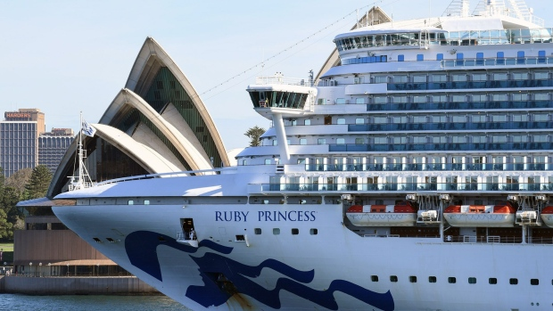 SYDNEY, AUSTRALIA - MARCH 19: Ruby Princess belonging to cruise ship company Princess Cruises, departs Sydney Harbour with no passengers and only crew on board as it passes the Opera House sails on March 19, 2020 in Sydney, Australia. Non-essential gatherings of 100 or more people indoors are banned, along with outdoor gatherings of more than 500 people while the government has declared a human biosecurity emergency. There are now 596 confirmed cases of COVID-19 In Australia, while there have been six confirmed deaths, five in NSW and one in Western Australia. (Photo by James D. Morgan/Getty Images)