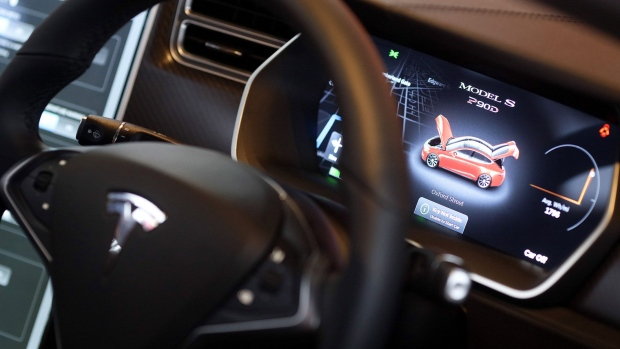 A digital display sits on the dashboard of a Tesla Model S P90D automobile inside the Tesla Motors Inc. showroom at a dealership, on Oxford Street in London, U.K., on Wednesday, Dec. 16, 2015.