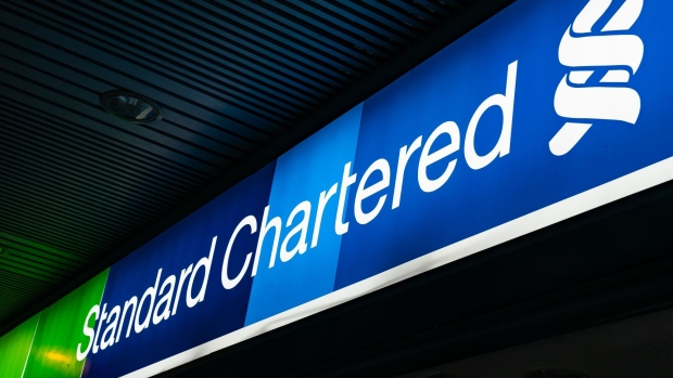 Signage for Standard Chartered Plc is displayed outside a bank branch in Hong Kong, China, on Saturday, Feb 16, 2019. Standard Chartered is scheduled to release full year earnings results on Feb. 26. Photographer: Anthony Kwan/Bloomberg