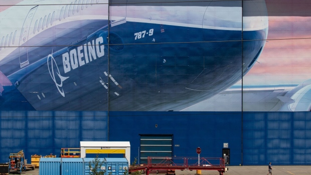 A worker walks outside of a Boeing Co. facility in Everett, Washington, U.S., on Wednesday, May 27, 2020. Boeing Co. unveiled the first and deepest of its planned job cuts, saying it would notify 6,770 employees in the U.S. this week that their positions would be eliminated.