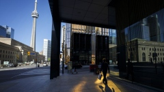A pedestrian walks on the sidewalk in the financial district of Toronto, Ontario, Canada, on Friday, May 22, 2020. Whether the PATH, a subterranean network that provides connections between major commuter stations, over 80 properties, including the headquarters of Canada's five largest banks, and 1,200 retail spots, can return to its glory days will depend initially on how quickly Bay St. firms return workers to their offices. Photographer: Bloomberg/Bloomberg