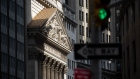 A streetlight stands in front of the New York Stock Exchange (NYSE) in New York, U.S., on Monday, July 20, 2020. U.S. stocks fluctuated in light trading as investors are keeping an eye on Washington, where lawmakers will begin hammering out a rescue package to replace some of the expiring benefits earlier versions contained.