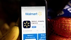 The Walmart application is displayed in the App Store on a smartphone in an arranged photograph taken in Arlington, Virginia, U.S., on Tuesday, May 19, 2020. Walmart Inc. posted strong quarterly sales fueled by coronavirus-related stockpiling, showing how it's one of the few retailers thats thriving even amid the unprecedented carnage in the U.S. retail sector. Photographer: Andrew Harrer/Bloomberg