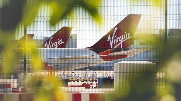 A security fence stands near grounded passenger aircraft, operated by Virgin Atlantic Airways Ltd., at Manchester Airport, operated by Manchester Airport Plc, in Manchester, U.K., on Monday, June 1, 2020.