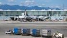 A Lufthansa flight loads up on the tarmac at Vancouver International Airport last month.