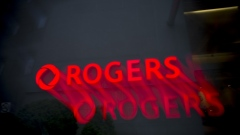 Rogers Communications Inc. signage illuminated at night is seen in this long exposure photograph taken in Toronto, Ontario, Canada, on Wednesday, May 17, 2017. Rogers Communications, Canada's largest wireless carrier, is leveraging organic growth in the country's wireless market to expand its subscriber base.