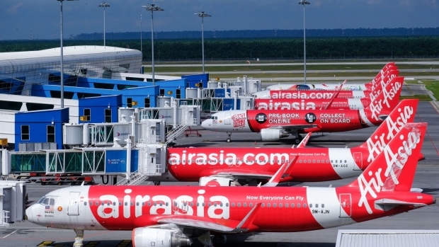 AirAsia Group Bhd. aircraft stand on the tarmac at Kuala Lumpur International Airport 2 (KLIA 2) in Sepang, Selangor, Malaysia, on Monday, Aug. 24, 2020. AirAsia is scheduled to report its quarterly results on Aug. 28. Photographer: Samsul Said/Bloomberg