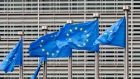 A line of European Union (EU) flags fly from flagpoles outside the Berlaymont building, which houses offices of the European Commission, in Brussels, Belgium, on Monday, June 8, 2020