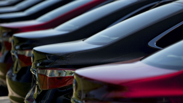 Vehicles sit on display for sale on the lot of a car dealership in Peoria, Illinois. Photographer: Daniel Acker