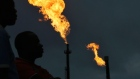 Gas flares burn from pipes at an oil flow station in Idu, Rivers State, Nigeria. Photographer: George Osodi/Bloomberg