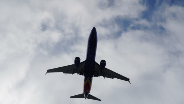 A Boeing 737 Next Generation (737NG) aircraft, operated by Southwest Airlines Co., flies into San Diego International Airport (SAN) in San Diego, California, U.S., on Monday, April 27, 2020. U.S. airlines reached preliminary deals to access billions of dollars in federal aid, securing a temporary lifeline as the industry waits for customers to start flying again. Photographer: Bing Guan/Bloomberg