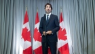 Justin Trudeau speaks with the media before the first day of a Liberal cabinet retreat