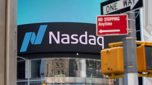 Signage is displayed outside the Nasdaq MarketSite in the Times Square neighborhood of New York, U.S., on Monday, July 20, 2020.