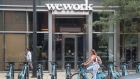 A sign marks the location of a WeWork office facility on August 14, 2019 in Chicago, Illinois. WeWork, a real estate firm that leases shared office space, announced today that it had filed a financial prospectus with regulators to become a publicly traded company.