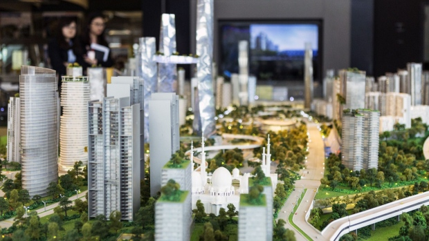 A model of the proposed Bandar Malaysia development, which Iskandar Waterfront Holdings Sdn. and China Railway Engineering Corp. bought 60 percent of in December last year for 7.41 billion ringgit, stands in a showroom in Kuala Lumpur, Malaysia, on Friday, Oct. 07, 2016. The development will host terminals for a planned high-speed rail line connecting Kuala Lumpur to Singapore and has an estimated sales value of 150 billion ringgit. Photographer: Charles Pertwee/Bloomberg