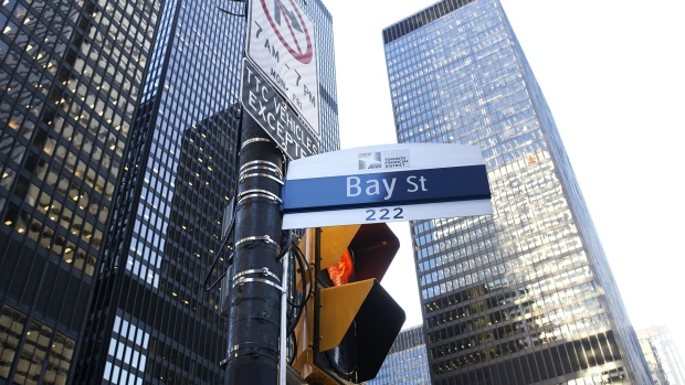 "A ""Bay Street"" sign is displayed in the financial district of Toronto, Ontario, Canada, on Friday, Feb. 21, 2020. Canadian stocks declined with global markets, as authorities struggled to keep the coronavirus from spreading more widely outside China. However, investors flocking to safe havens such as gold offset the sell-off in Canada's stock market."