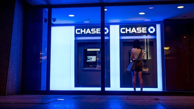 A customer uses an automatic teller machine (ATM) at a JPMorgan Chase & Co. bank branch in Chicago.