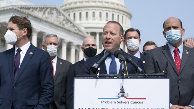 Representative Josh Gottheimer, a Democrat from New Jersey and co-chair of the House Problem Solvers Caucus, center, speaks during a news conference at the U.S. Capitol in Washington, D.C., U.S., on Tuesday, Sept. 15, 2020. The House Speaker today said Congress should stay in session until lawmakers and the White House get an agreement on another stimulus package, something that's looked increasingly distant amid partisan battling.
