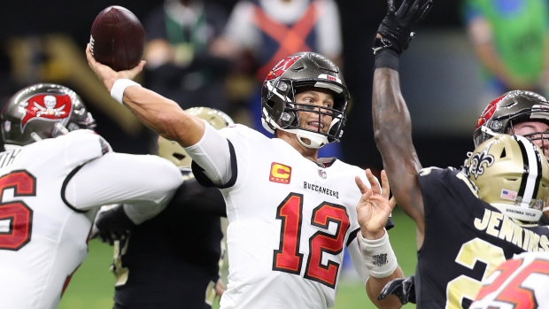 NEW ORLEANS, LOUISIANA - SEPTEMBER 13: Tom Brady #12 of the Tampa Bay Buccaneers throws against the New Orleans Saints during the third quarter at the Mercedes-Benz Superdome on September 13, 2020 in New Orleans, Louisiana. (Photo by Chris Graythen/Getty Images)