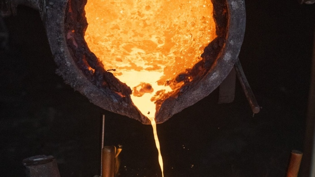 Molten iron is poured out of a crucible into sand forms at a foundry in Greenville, Ohio, U.S., on Tuesday, July 21, 2020. U.S. raw steel production rose to 1.306 million tons from 1.289 million tons a week earlier, the American Iron and Steel Institute said in an email. Photographer: Ty Wright/Bloomberg