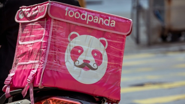 An insulated food bag branded with Foodpanda logo sits on the back of a motorcycle in Hong Kong, China, on Thursday, Feb. 20, 2020. A group of 59 Hong Kong police officers are being quarantined after a fellow officer preliminarily tested positive for the virus, the city's police force said in a statement on Facebook. Photographer: Paul Yeung/Bloomberg