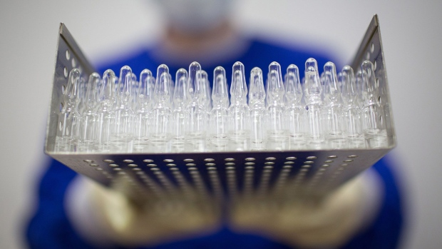Tray containing unlabeled ampoules of the 'Gam-COVID-Vac' COVID-19 vaccine developed by the Gamaleya National Research Center for Epidemiology and Microbiology, and the Russian Direct Investment Fund. Photographer: Andrey Rudakov/Bloomberg