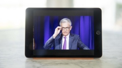 Jerome Powell, chairman of the U.S. Federal Reserve, speaks during a virtual news conference seen on a tablet computer in Tiskilwa, Illinois, U.S., on Wednesday, Sept. 16, 2020. The Federal Reserve left interest rates near zero and signaled it would hold them there through at least 2023 to help the U.S. economy recover from the coronavirus pandemic.