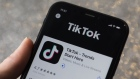 The download page for ByteDance Ltd.'s TikTok app is arranged for a photograph on a smartphone in Sydney, New South Wales, Australia, on Monday, Sept. 14, 2020.