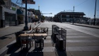 Empty tables and chairs stand outside a restaurant on Jefferson Street at Fisherman's Wharf in San Francisco, California, U.S., on Wednesday, July 8, 2020. Built from the rubble of the 1906 earthquake and fire, the Wharf is now facing a different sort of rebuild after Covid-19 economically flattened it.