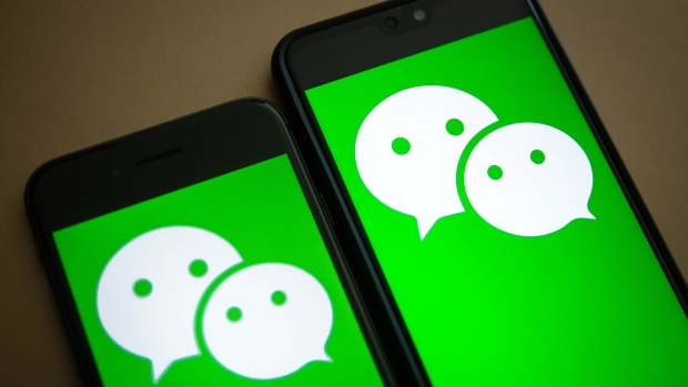The logo for Tencent Holdings Ltd.'s WeChat app is arranged for a photograph on smartphones in Hong Kong, China, on Friday, Aug. 7, 2020. President Donald Trump signed a pair of executive orders prohibiting U.S. residents from doing business with the Chinese-owned TikTok and WeChat apps beginning 45 days from now, citing the national security risk of leaving Americans' personal data exposed.