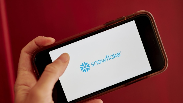Snowflake Inc. signage is displayed on a smartphone in an arranged photograph taken in the Brooklyn borough of New York, U.S., on Wednesday, Sept. 16, 2020. Snowflake Inc. soared in a euphoric stock-market debut that transformed the eight-year-old software company into business valued at about $72 billion. Photographer: Gabby Jones/Bloomberg