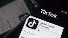 The download page for ByteDance Ltd.'s TikTok app is arranged for a photograph on a smartphone in Sydney, New South Wales, Australia, on Monday, Sept. 14, 2020. Oracle Corp. is the winning bidder for a deal with TikTok's U.S. operations, people familiar with the talks said, after main rival Microsoft Corp. announced its offer for the video app was rejected.
