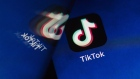 ByteDance Ltd.'s TikTok app button, reflected in a mirror, is arranged for a photograph on a smartphone in Sydney, New South Wales, Australia, on Monday, Sept. 14, 2020. Oracle Corp. is the winning bidder for a deal with TikTok's U.S. operations, people familiar with the talks said, after main rival Microsoft Corp. announced its offer for the video app was rejected.
