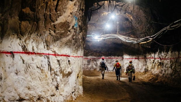 Miners walk through an underground tunnel at a gold mine in South Africa.