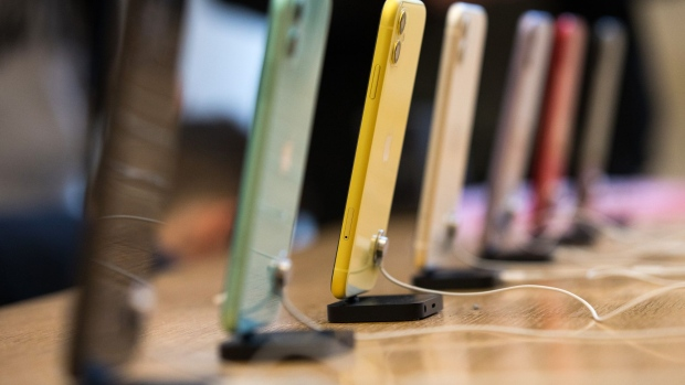 A row of Apple Inc. iPhone 11 smartphones