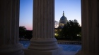 The U.S. Capitol stands past columns of the U.S. Supreme Court at dusk in Washington, D.C., U.S., on Thursday, April 16, 2020. President Donald Trump threatened Wednesday to try to force both houses of Congress to adjourn -- an unprecedented move that would likely raise a constitutional challenge -- so that he can make appointments to government jobs without Senate approval.
