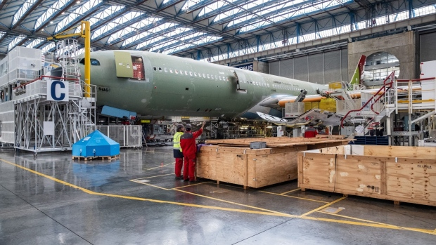 An Airbus A330neo passenger aircraft stands on the final assembly line at the Airbus SE factory in Toulouse, France, on Monday, Nov. 26, 2018. Known as the A330neo for New Engine Option, the model was originally scheduled to join the TAP Air Portugal fleet from the end of 2017.