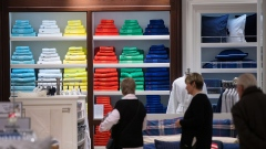 A selection of Ralph Lauren Corp. bath towels sit stacked on display stands inside a Galeria Kaufhof department store, operated by Hudson's Bay Co., in Berlin, Germany, on Wednesday, Dec. 6, 2017. Austrian property developer Rene Benko is taking a second run at consolidating Germany's dusty department stores, making an unsolicited bid for the Kaufhof chain now owned by Toronto-based Hudson's Bay. Photographer: Krisztian Bocsi/Bloomberg