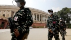 Armed members of the paramilitary forces wearing protective masks and face shields patrol the premises of Parliament House in New Delhi, India, on Sunday, Sept. 13, 2020. Indian lawmakers returned to the nation's parliament for the first time since the start of the pandemic with Prime Minister Narendra Modi's government bracing for a tumultuous session as the country sets new global records in coronavirus infections, and with a tense border standoff with China dominating the headlines. Photographer: T. Narayan/Bloomberg